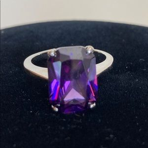 Sterling silver ring with purple emerald cut stone